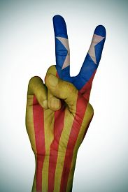 stock photo of v-day  - the hand of a young man giving the V sign patterned with the Estelada - JPG