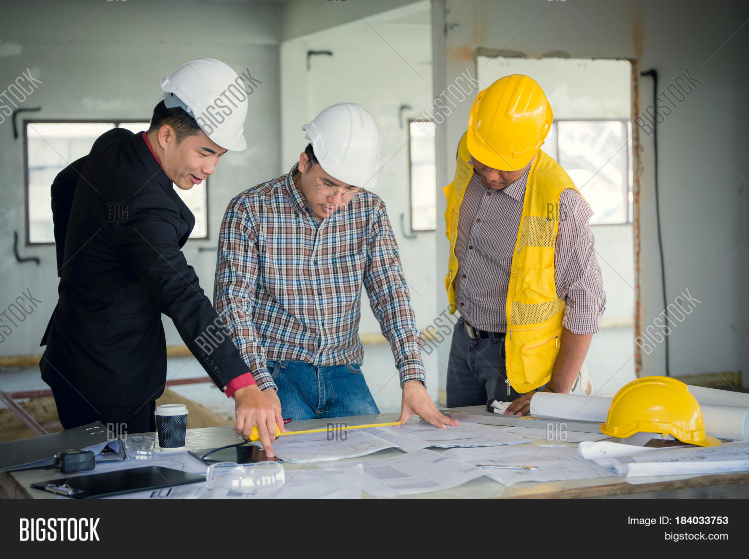 Management consulting engineers image photo bigstock management consulting and engineers and foreman working with blueprint and drawing on work table for malvernweather Choice Image