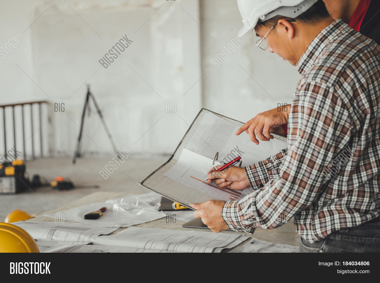 Management consulting engineers image photo bigstock management consulting with engineers working with blueprint and drawing on work table in for managem malvernweather Choice Image