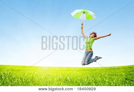 young girl jumping with umbrellas