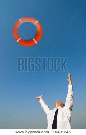 businessman and life preserver