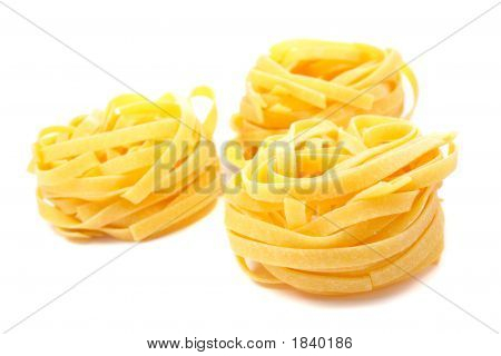 Three Uncooked Pasta Nests