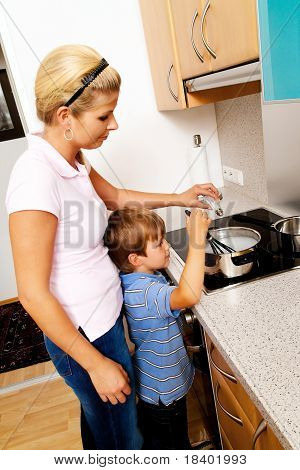 Woman in kitchen with electric stove