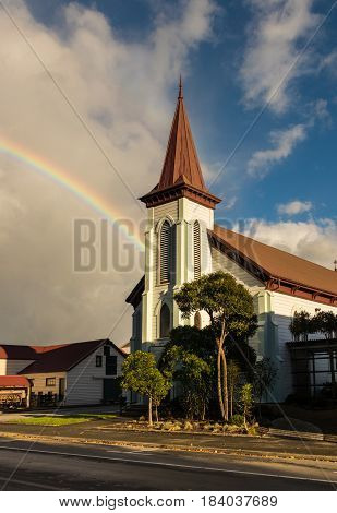 Rainbow behind a big wooden church in Masterton New Zealand.