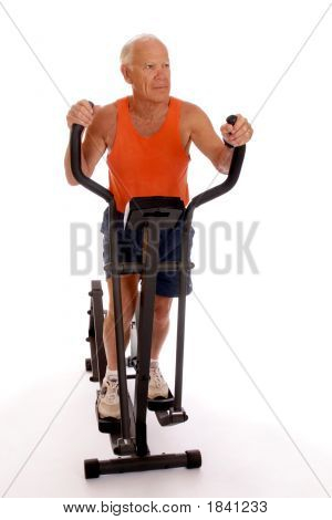 Senior Working Out On Home Machine