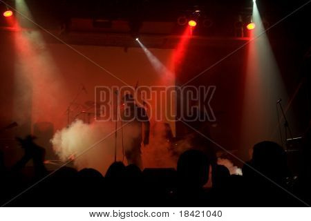 Rock concert, blurred unrecognizable musicians on the stage