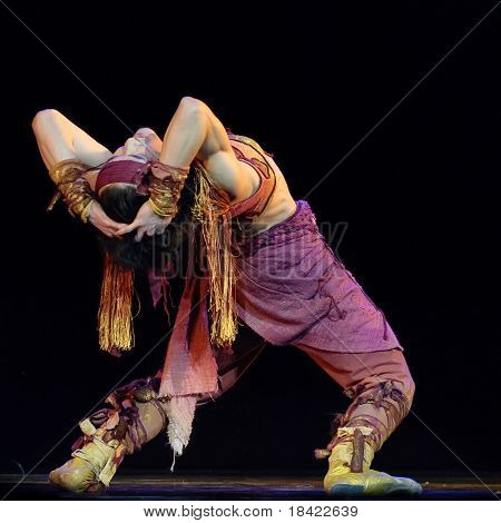 Chinese Mongolian ethnic dancer performs solo dance on stage