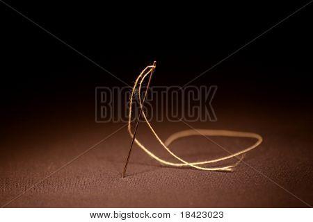 Needle with thread