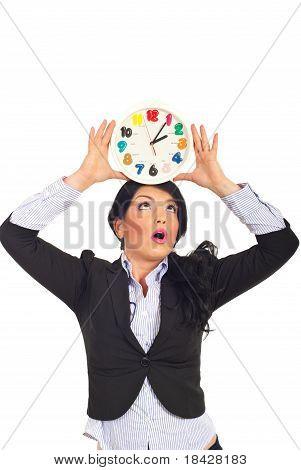Surprised Woman Holding Clock Overhead