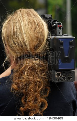 Reporter viewed from back.