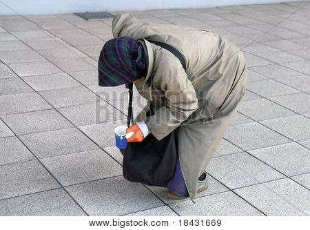 Old woman begging on the street