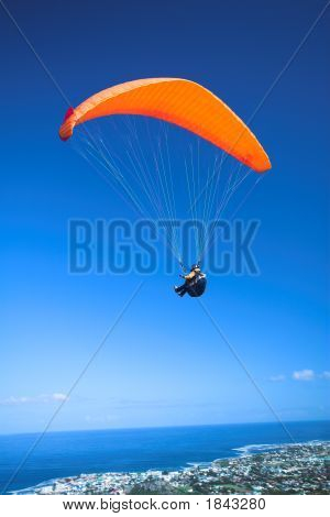 Paraglider Launching From The Mountain Ridge