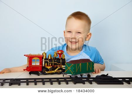 Boy Playing With Toy Railway