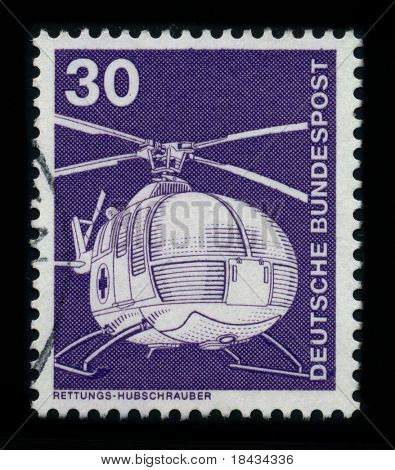 GERMANY - CIRCA 1980: A stamp shows image of the dedicated to the Helicopter is a type of rotorcraft in which lift and thrust are supplied by one or more engine driven rotors, circa 1980.