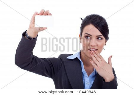 Surprised Young Woman Holding Card