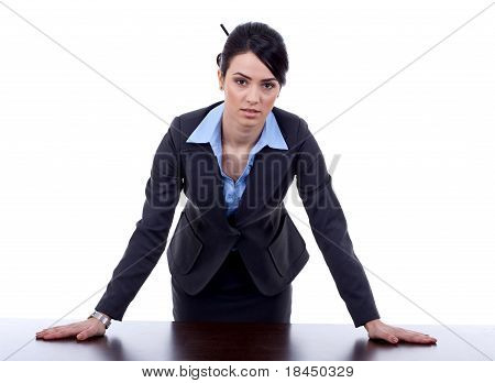 Business Woman Standing Behind A Desk