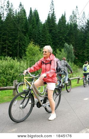 Mature Woman On Her Bicycle