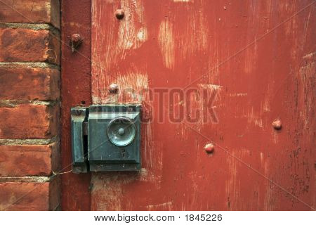 Close-Up Of Doorknob And Brick Wall.