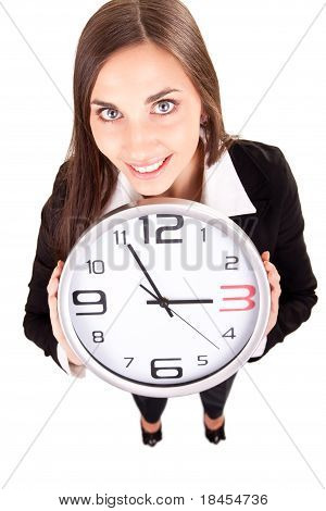 Businesswoman In Suit Holding A Clock