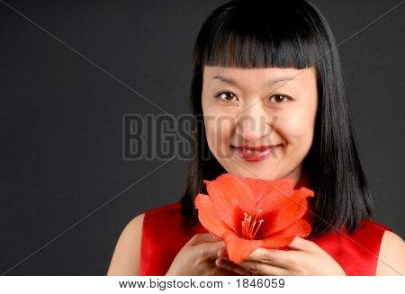 Asian Woman And Amaryllis