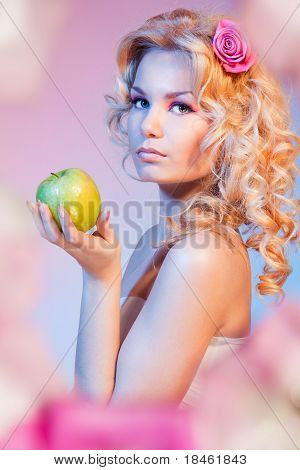 Curly Blond Woman With Green Apple