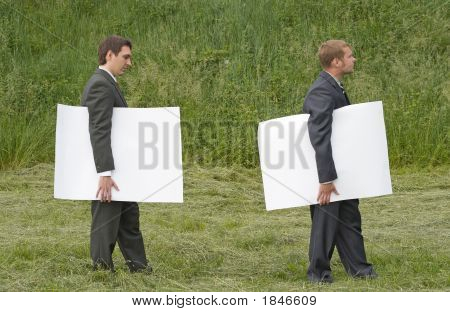 Businessmen Walking With Sheets Of Paper