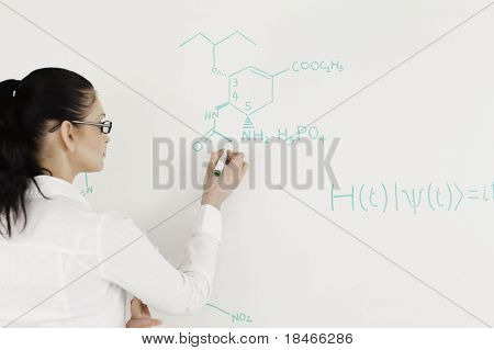 Scientist Writing A Formula