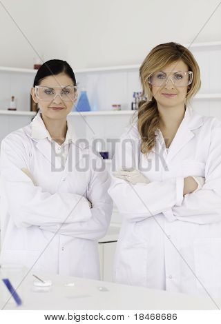 Two Female Scientists Looking At The Camera