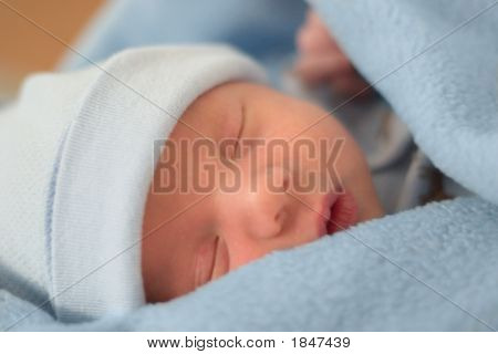 Sleeping Baby In Blue Blanket