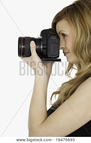 Lovely Blond-haired Woman Taking A Photo With A Camera