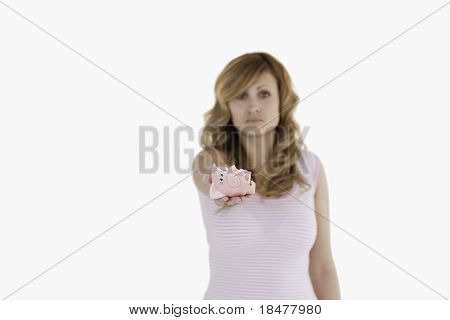 Attractive Blond-haired Woman Showing Her Broken Piggybank