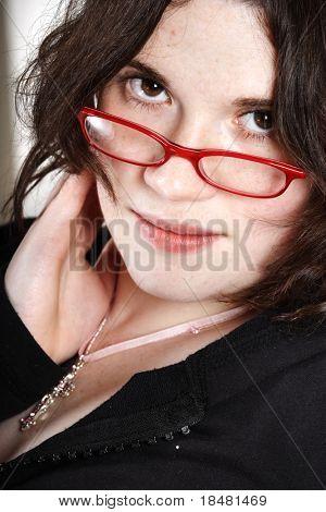 Brunette secretary with red glasses