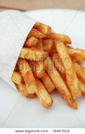 Bag of French fries on Styrofoam plate.