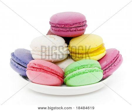 Big plate of colorful French macaroons in different flavors isolated on white studio background