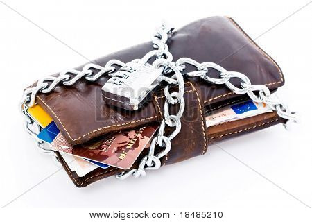 Leather wallet with credit cards and Euro currency locked with a chain and combination lock, isolated on white background