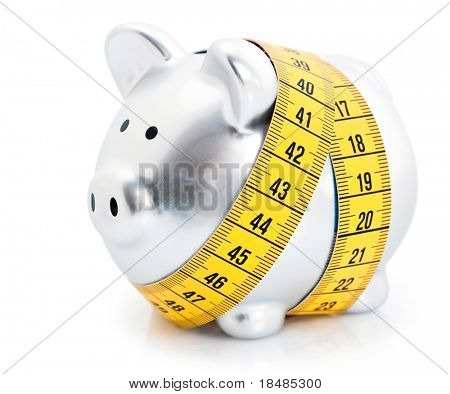 Measuring tape wrapped around piggy bank or money box, isolated on white background