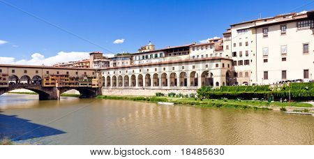 Wide angle view of Ponte Vecchio bridge over Arno river in city of Florence, Tuscany, Italy.