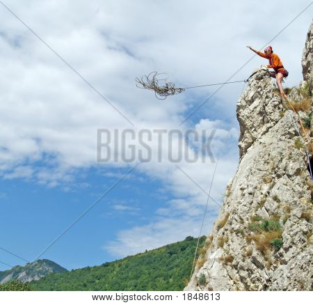 Climber Throwing Rope Down