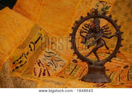 Bronce Shiva en amarillo - naranja