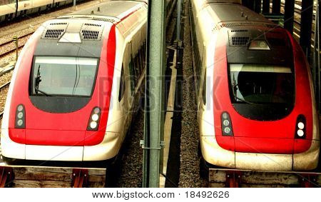 Two trains at a station