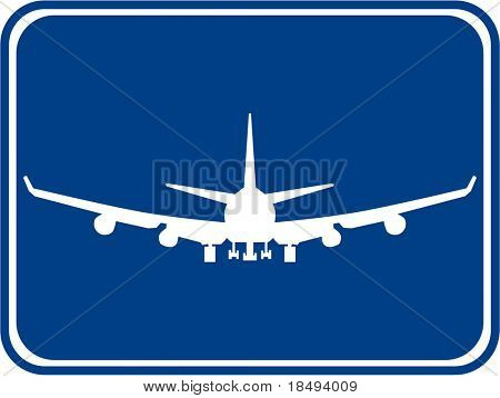 Silhouette of a air plane with a blue background.