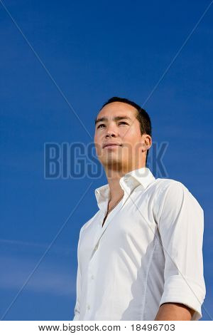 Smart handsome asian man looking forward in a positive and brave manner