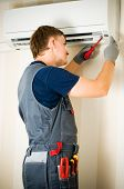 pic of air conditioner  - man repair air conditioner - JPG