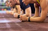 fitness, sport, exercising, training and healthy lifestyle concept - group of people doing plank exe poster
