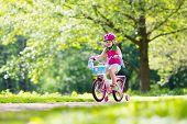 Child Riding Bike. Kid On Bicycle. poster