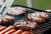 stock photo of barbecue grill  - Grilling burgers and hot dogs - JPG