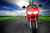 picture of nomads  - Motorcycle moving very fast along motion blurred road - JPG