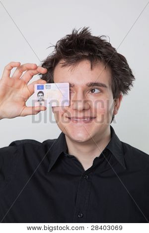 Young Man Laughing With His Driver License