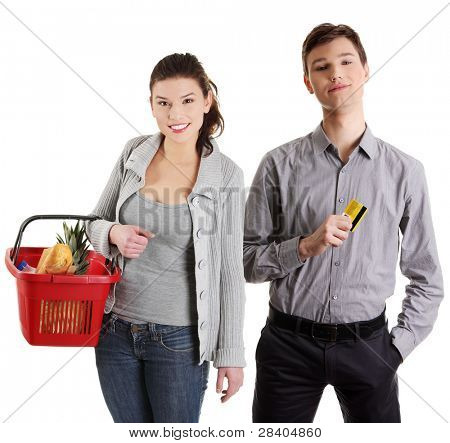 Shopping young couple with grocery items. Isolated over white background.