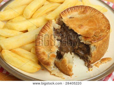 Individual steak & kidney pie with chips.